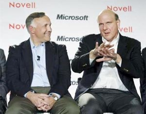Microsoft CEO Steve Ballmer (R) talks as Novell President and CEO Ron Hovsepian watches during a news event to announce a set of collaboration agreements for Microsoft's Windows and Novell's Linux interoperability and support in San Francisco November 2, 2006