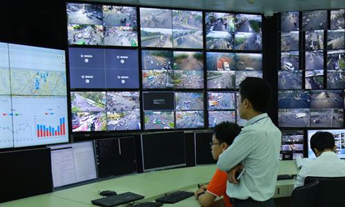 FPT và Grab sẽ triển khai thí điểm hệ thống giám sát tín hiệu giao thông. Ảnh: FPT.