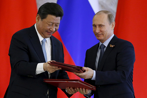 Chủ tịch Trung Quốc Tập Cận Bình (bên trái)và Tổng thống Nga Vladimir Putin (bên phải). Ảnh: Reuters.